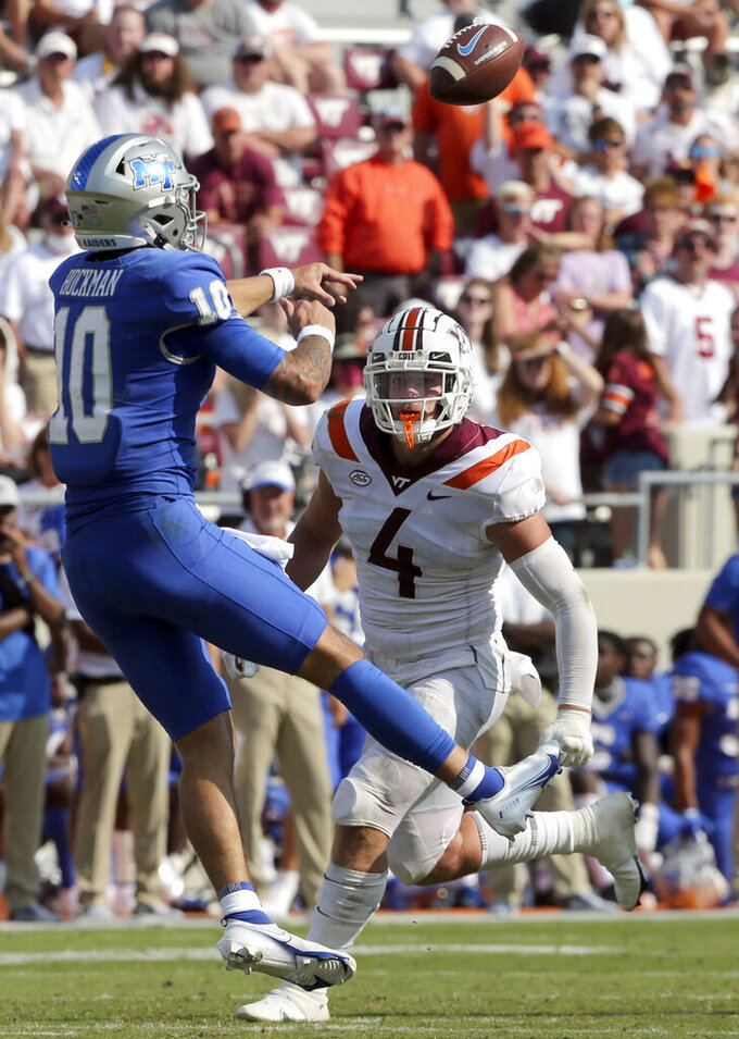 Middle Tennessee quarterback Bailey Hockman (10) throws while rushed by Virginia Tech linebacker Dax Hollifield (4) in the second half of an NCAA college football game, Saturday, Sept. 11, 2021, in Blacksburg Va. (AP Photo/Matt Gentry)