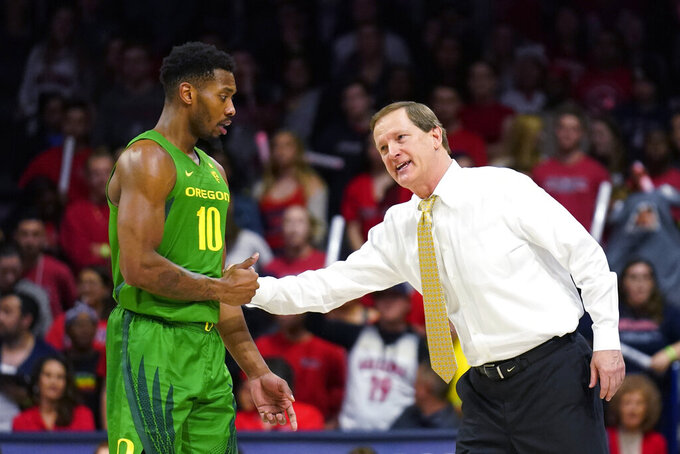 Oregon coach Dana Altman jokes with Shakur Juiston (10) during the first half of the team's NCAA college basketball game against Arizona on Saturday, Feb. 22, 2020, in Tucson, Ariz. (AP Photo/Rick Scuteri)