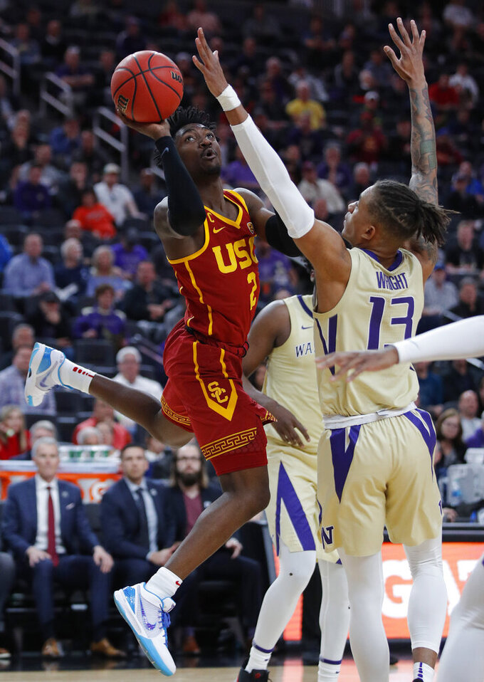 Southern California's Jonah Mathews (2) shoots over Washington's Hameir Wright during the second half of an NCAA college basketball game in the quarterfinal round of the Pac-12 men's tournament Thursday, March 14, 2019, in Las Vegas. (AP Photo/John Locher)
