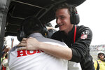 "This photo provided by IndyCar shows team owner George Steinbrenner IV hugging a Honda Performance Development employee after driver Colton Herta won the IndyCar Classic auto race in Austin, Texas on Sunday, March 24, 2019.  Instead of trying to be ""the next George Steinbrenner,"" George Steinbrenner IV is trying to be ""the next Roger Penske."" He's 22 and just became the youngest team owner to win a race in IndyCar. (Joe Skibinski/IndyCar via AP)"