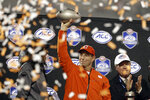 Clemson head coach Dabo Swinney raises the trophy after Clemson won the Atlantic Coast Conference championship NCAA college football game against Pittsburgh in Charlotte, N.C., Saturday, Dec. 1, 2018. (AP Photo/Chuck Burton)