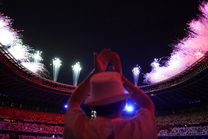 Fireworks explode during the closing ceremony in the Olympic Stadium at the 2020 Summer Olympics, Sunday, Aug. 8, 2021, in Tokyo, Japan. (AP Photo/David Goldman)