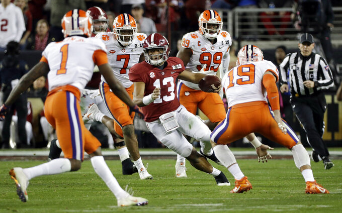 Alabama's Tua Tagovailoa scrambles during the first half of the NCAA college football playoff championship game against Clemson, Monday, Jan. 7, 2019, in Santa Clara, Calif. (AP Photo/David J. Phillip)
