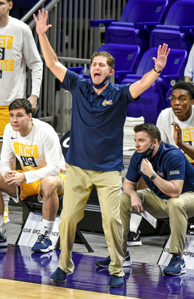 Drexel coach Zach Spiker yells to the team during the first half against Elon in an NCAA college basketball game for the Colonial Athletic Association men's tournament championship in Harrisonburg, Va., Tuesday, March 9, 2021. (AP Photo/Daniel Lin)