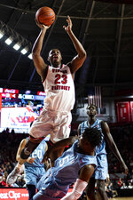 FILE - In this Jan. 17, 2019, file photo, Western Kentucky center Charles Bassey (23) is called fo an offensive foul against Florida International guard Antonio Daye Jr. (5) during an NCAA college basketball game in Bowling Green, Ky. Bassey enters this season as one of the top pro prospects from any college that isn't in a major conference or in the preseason Top 25. (Austin Anthony/Daily News via AP, File)
