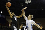 Gonzaga forward Jeremy Jones, left, shoots over San Diego forward Yauhen Massalski during the first half of an NCAA college basketball game Saturday, Feb. 16, 2019, in San Diego. (AP Photo/Gregory Bull)