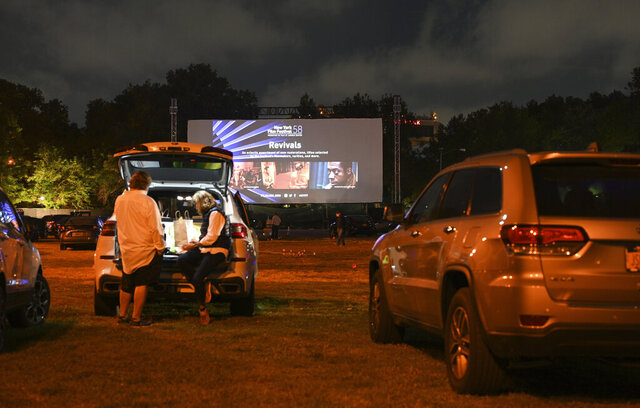 FILE - Filmgoers attend the