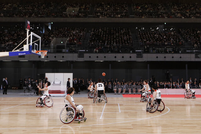 FILE - In this Feb. 2, 2020, file photo, members of Japan's national wheelchair basketball team warm up on the court during a grand opening ceremony of the Ariake Arena, a venue for volleyball at the Tokyo 2020 Olympics and wheelchair basketball during the Paralympic Games, in Tokyo. The Tokyo 2020 Paralympic schedule remains essentially unchanged for the event postponed until next year, organizers said on Monday, Aug. 3, 2020. Tokyo organizers made the same announcement several weeks ago for the postponed Olympics. The Paralympics open on Aug. 24, 2021, and close on Sept. 5. The Olympics are to open on July 23. (AP Photo/Jae C. Hong, File)