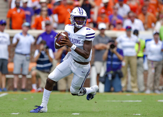 Furman quarterback Darren Grainger breaks out of the pocket during the first half of an NCAA college football game against Clemson Saturday, Sept. 1, 2018, in Clemson, S.C. (AP Photo/Richard Shiro)