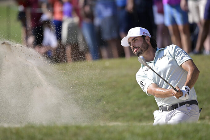 Abraham Ancer, of Mexico, hits from a bunker onto the 16th green during the final round of the Valspar Championship golf tournament, Sunday, May 2, 2021, in Palm Harbor, Fla. (AP Photo/Phelan M. Ebenhack)