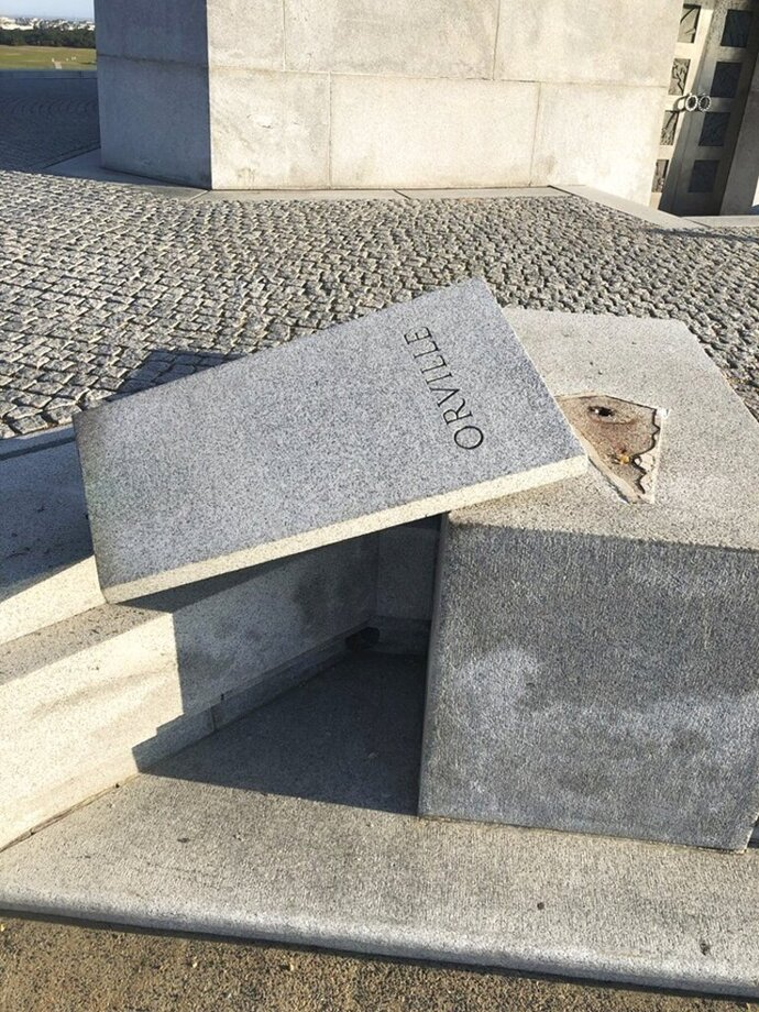 The National Park Service says a copper bust of aviation pioneer Orville Wright has been stolen from the Wright Brothers National Memorial in the Outer Banks of North Carolina. The Park Service and local law enforcement officials are investigating the case and are asking the public for any information. The agency in a statement says the monument was damaged either Saturday evening, Oct. 12, 2019 or Sunday morning. The granite base that the bust was mounted to was toppled and damaged. (The National Park Service via AP)