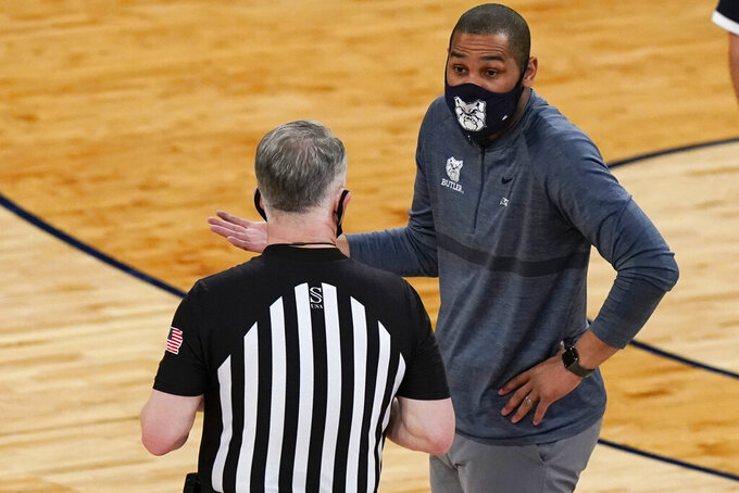 Butler coach LaVall Jordan, right, argues a call with a referee during the second half of the team's NCAA college basketball game against Creighton in the Big East men's tournament Thursday, March 11, 2021, in New York. (AP Photo/Frank Franklin II)