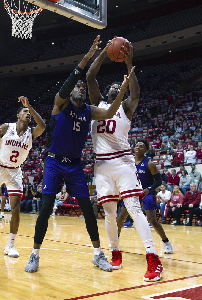 North Alabama's Cameron Diggs (15) and Indiana's De'Ron Davis (20) battle for a rebound during the second half of an NCAA college basketball game, Tuesday, Nov. 12, 2019, in Bloomington, Ind. Indiana won 91-65. (AP Photo/Doug McSchooler)