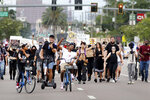 Protesters move down W Kennedy Boulevard to join a larger gathering of protesters on Tuesday, June 2, 2020, in front of the Fox 13 Tampa Bay news station in Tampa, Fla. George Floyd's death in Minneapolis on May 25 while in police custody has sparked global protests. (Douglas R. Clifford/Tampa Bay Times via AP)