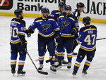 St. Louis Blues' David Perron (57) celebrates with Ryan O'Reilly (90), Torey Krug (47), Mike Hoffman (68) and Brayden Schenn (10) after scoring his second goal of the night, during the third period of an NHL hockey game against the Minnesota Wild, Thursday, May 13, 2021 in St. Louis. The Blues erased a 3-0 deficit to win 7-3. (AP Photo/Tom Gannam)