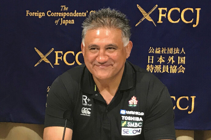 Japan head coach Jamie Joseph smiles while speaking during a press conference in Tokyo Friday, Aug. 30, 2019. Joseph has set an ambitious goal of reaching the quarterfinals when the 2019 Rugby World Cup begins in Japan next month. Currently ninth in the world rankings after winning its third Pacific Nations title this month, Japan is in Pool A with Ireland, Scotland, Russia and Samoa. (AP Photo/Jim Armstrong)