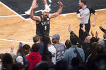 Brooklyn Nets forward Jared Dudley (6) reacts with the fans during the first half of Game 4 of a first-round NBA basketball playoff series against the Philadelphia 76ers, Saturday, April 20, 2019, in New York. (AP Photo/Mary Altaffer)