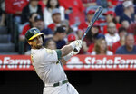 FILE - In this Sept. 29, 2018 file photo Oakland Athletics' Khris Davis follows through on his two-run home run against the Los Angeles Angels during the first inning of a baseball game, in Anaheim, Calif. Davis, last season's major league home run leader, has reached agreement with the  Athletics on a one-year contract to avoid salary arbitration. The A's also said Friday, Jan. 11, 2019, they had agreed to one-year deals with left-hander Sean Manaea, infielders Jurickson Profar and Marcus Semien and outfielder Mark Canha to avoid arbitration. (AP Photo/Marcio Jose Sanchez, File)