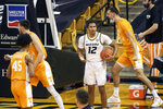Missouri's Dru Smith, center, argues a called foul during the first half of an NCAA college basketball game against Tennessee Wednesday, Dec. 30, 2020, in Columbia, Mo. (AP Photo/L.G. Patterson)