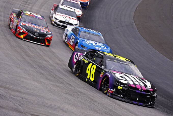Jimmie Johnson (48) leads Ryan Blaney (12), Erik Jones (20) and Brad Keselowski (2) through a turn during a NASCAR Cup Series auto race, Sunday, April 7, 2019, in Bristol, Tenn. (AP Photo/Wade Payne)