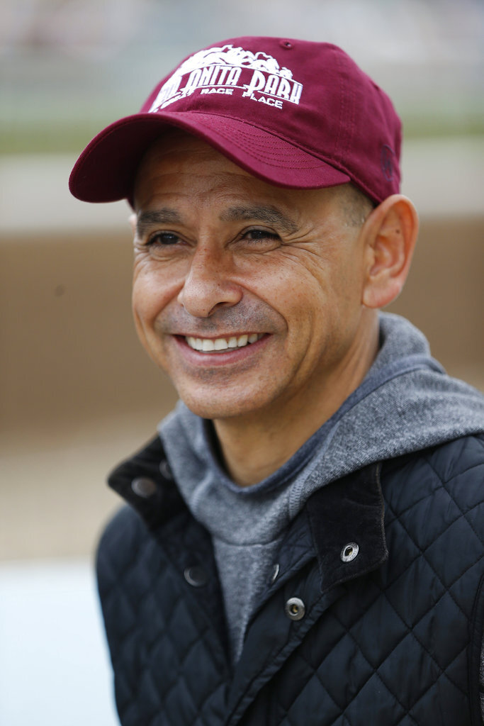 In this May 24, 2018, photo Hall of Fame jockey Mike Smith takes questions about horse Justify at the Santa Anita Park in Arcadia, Calif. Mike Smith has ridden some of the best horses in history, Zenyatta and Arrogate come to mind, and is the career leader in Breeders' Cup victories. Now at 52, he has a chance to make history aboard Justify by winning the Belmont and completing a Triple Crown sweep. (AP Photo/Damian Dovarganes)