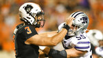Oklahoma State quarterback Spencer Sanders (3) defends against a tackle by Kansas State linebacker Cody Fletcher (55) following a pass, during an NCAA college football game Saturday, Sept. 25, 2021, in Stillwater, Okla. (AP Photo/Brody Schmidt)