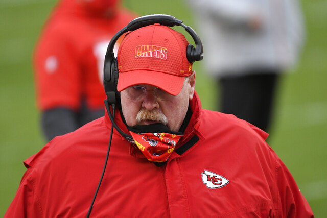 Kansas City Chiefs head coach Andy Reid talks with players on the sideline during the first half of an NFL divisional round football game against the Cleveland Browns, Sunday, Jan. 17, 2021, in Kansas City. (AP Photo/Reed Hoffmann)