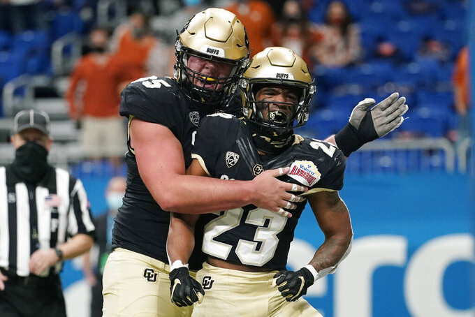 Colorado running back Jarek Broussard (23) celebrates his touchdown against Texas with Jared Poplawski (85) during the first half of the Alamo Bowl NCAA college football game Tuesday, Dec. 29, 2020, in San Antonio. (AP Photo/Eric Gay)