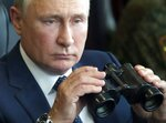 Russian President Vladimir Putin holds a binoculars as he watches the joint strategic exercise of the armed forces of the Russian Federation and the Republic of Belarus Zapad-2021 at the Mulino training ground in the Nizhny Novgorod region, Russia, Monday, Sept. 13, 2021. The military drills attend by servicemen of military units and divisions of the Western Military District, representatives of the leadership headquarters and personnel of military contingents of the armed forces of Armenia, Belarus, India, Kazakhstan, Kyrgyzstan and Mongolia. (Sergei Savostyanov, Sputnik, Kremlin Pool Photo via AP)