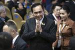 Thailand Prime Minister Prayuth Chan-ocha greets during the ASEAN Business and Investment Summit (ABIS) Nonthaburi, Thailand, Saturday, Nov. 2, 2019. (AP Photo/Wason Wanichakorn)