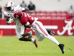 Alabama defensive back Daniel Wright stops Auburn running back Tank Bigsby (4) during an NCAA college football game Saturday, Nov. 28, 2020, in Tuscaloosa, Ala. (Mickey Welsh/The Montgomery Advertiser via AP)