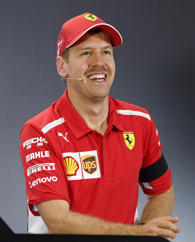 Sebastian Vettel of Germany smiles as he attends a press conference after qualifying for the Australian Grand Prix in Melbourne, Australia, Saturday, March 16, 2019. Vettel is third place on the grid for the first race of the year, Sunday. (AP Photo/Andy Brownbill)