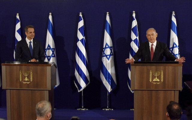 Israeli Prime Minister Benjamin Netanyahu, right,  and Greek Prime Minister Kyriakos Mitsotakis give joint statements in Jerusalem, Tuesday, June 16, 2020. (Debbie Hill, UPI Pool via AP)