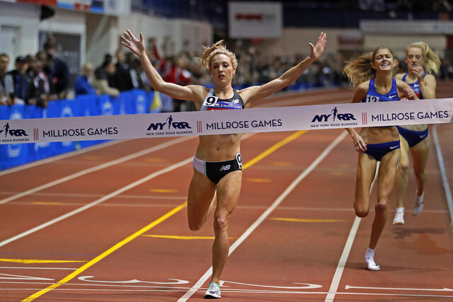 Elle Purrier reacts after winning the NYRR Wanamaker Mile at the Millrose Games track and field meet Saturday, Feb. 8, 2020, in New York. (AP Photo/Adam Hunger)
