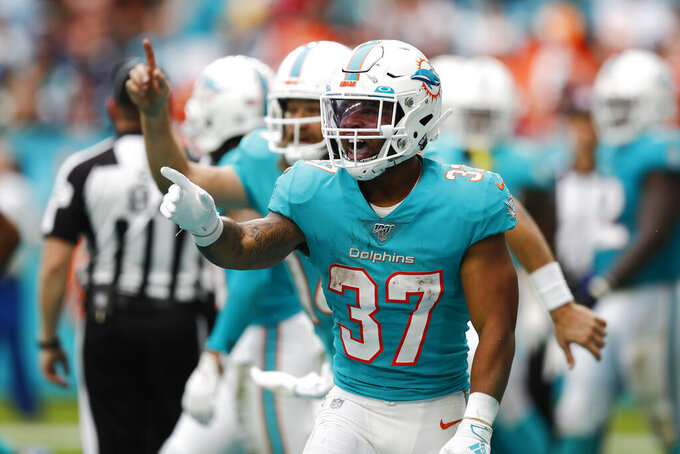Miami Dolphins running back Myles Gaskin (37) gesture towards the sidelines after scoring a touchdown, during the second half at an NFL football game against the Cincinnati Bengals, Sunday, Dec. 22, 2019, in Miami Gardens, Fla. (AP Photo/Brynn Anderson)