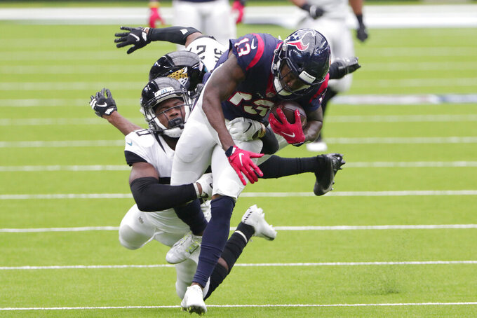 Houston Texans wide receiver Brandin Cooks (13) is hit by Jacksonville Jaguars safety Daniel Thomas (20) after a catch during the second half of an NFL football game Sunday, Oct. 11, 2020, in Houston. (AP Photo/Michael Wyke)