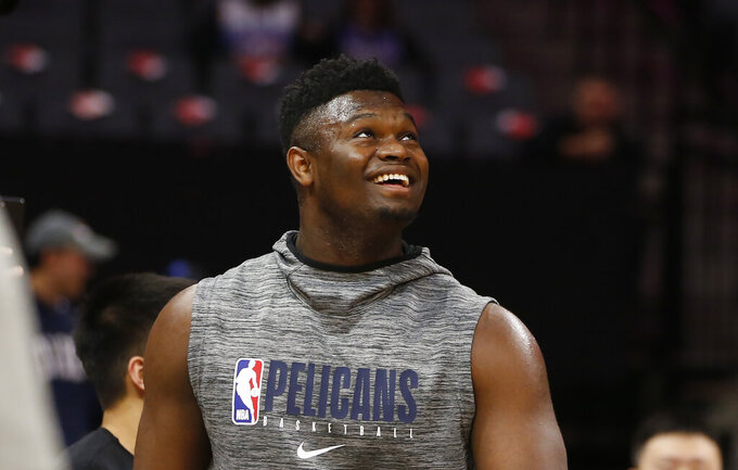 In this Saturday Jan, 4, 2020, photo, New Orleans Pelicans rookie Zion Williamson looks up during a workout before the Pelicans played the Sacramento Kings in an NBA basketball game in Sacramento, Calif. Williamson, who is recovering from a knee injury, has now participated in full-court and five-on-five drills as the top overall draft choice moves closer to making his league debut. (AP Photo/Rich Pedroncelli)