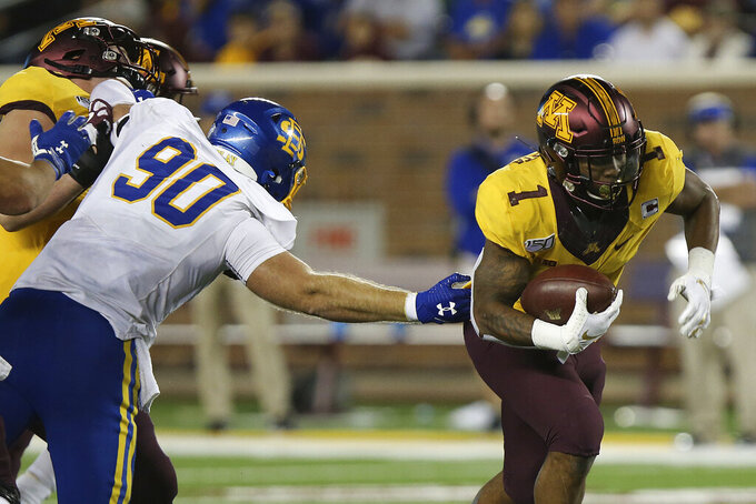 Minnesota running back Rodney Smith (1) breaks away from the defense of South Dakota State defensive end Ryan Earith (90) during an NCAA college football game Thursday, Aug. 29, 2019, in Minneapolis. Minnesota won 28-21. (AP Photo/Stacy Bengs)
