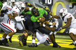 Oregon quarterback Anthony Brown (13) is sacked by Arizona defenders for a safety during the third quarter of an NCAA college football game Saturday, Sept. 25, 2021, in Eugene, Ore. (AP Photo/Andy Nelson)
