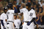 Detroit Tigers' Jonathan Schoop celebrates with Willi Castro (9) after hitting a grand slam against the Tampa Bay Rays in the seventh inning of a baseball game in Detroit, Friday, Sept. 10, 2021. (AP Photo/Paul Sancya)
