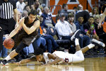 Lehigh guard Andrei Arion, left, collects a loose ball from Auburn guard Jamal Johnson during the second half of an NCAA college basketball game Saturday, Dec. 21, 2019, in Auburn, Ala. (AP Photo/Julie Bennett)