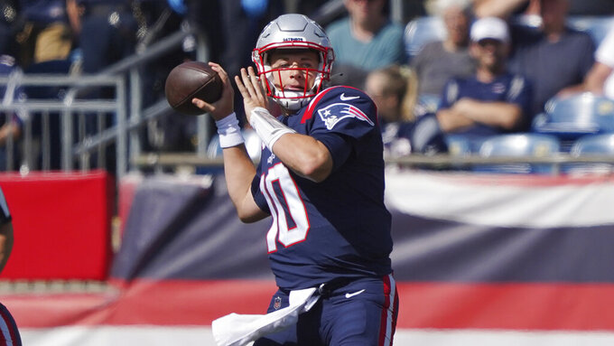 New England Patriots quarterback Mac Jones throws a pass during the first half of an NFL football game against the New Orleans Saints, Sunday, Sept. 26, 2021, in Foxborough, Mass. (AP Photo/Mary Schwalm)