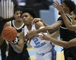 North Carolina's Caleb Love (2) drives to the basketagainst Wake Forest's Isaiah Mucius (1) during the second half of an NCAA college basketball game Wednesday, Jan. 20, 2021, in Chapel Hill, N.C. (Robert Willett/The News & Observer via AP)