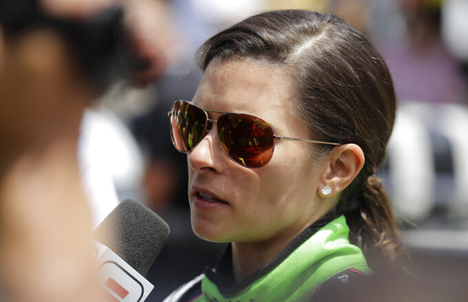 "FILE - In this May 27, 2018 file photo, Danica Patrick is interviewed following her release from the infield hospital after being checked following a crash in the Indianapolis 500 auto race at Indianapolis Motor Speedway in Indianapolis.  NBC Sports announced Wednesday, March 20, 2019,  that Patrick will be part of its inaugural broadcast of the Indianapolis 500, a project that will return Patrick to the famed Indianapolis Motor Speedway for the first time since she ended her career there last May with the second leg of the ""Danica Double.""  (AP Photo/Darron Cummings)"