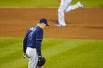 Tampa Bay Rays starting pitcher Blake Snell (4) reacts as New York Mets' Robinson Cano runs the bases after hitting a home run during the second inning of a baseball game Tuesday, Sept. 22, 2020, in New York. (AP Photo/Frank Franklin II)