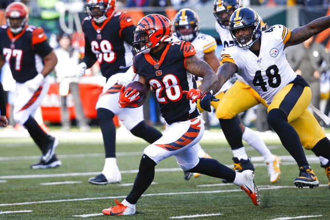 Cincinnati Bengals running back Joe Mixon (28) runs the ball past Pittsburgh Steelers outside linebacker Bud Dupree (48) during the second half an NFL football game, Sunday, Nov. 24, 2019, in Cincinnati. (AP Photo/Frank Victores)