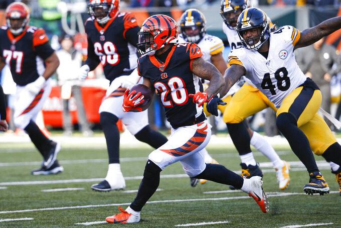 Cincinnati Bengals running back Joe Mixon (28) runs the ball past Pittsburgh Steelers outside linebacker Bud Dupree (48) during the second half an NFL football game, Sunday, Nov. 24, 2019, in Cincinnati. (AP Photo/Frank Victores)