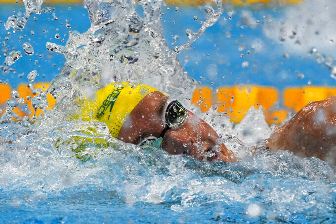 Emma McKeon, of Australia, swims in a women's 100-meter freestyle semifinal at the 2020 Summer Olympics, Thursday, July 29, 2021, in Tokyo, Japan. (AP Photo/Martin Meissner)