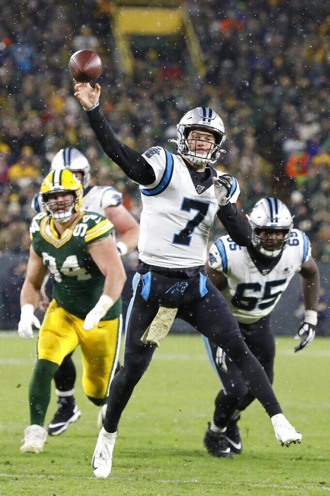 Carolina Panthers' Kyle Allen throws during the second half of an NFL football game against the Green Bay Packers Sunday, Nov. 10, 2019, in Green Bay, Wis. (AP Photo/Mike Roemer)