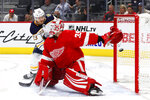 Buffalo Sabres center Sam Reinhart (23) scores against Detroit Red Wings goaltender Jimmy Howard (35) in the third period of an NHL hockey game Friday, Oct. 25, 2019, in Detroit. (AP Photo/Paul Sancya)